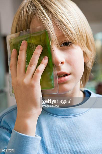 Boy with ice pack on his eye