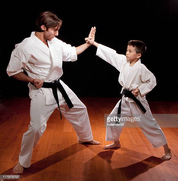 boy with karate instructor - punching stock pictures, royalty-free photos & images