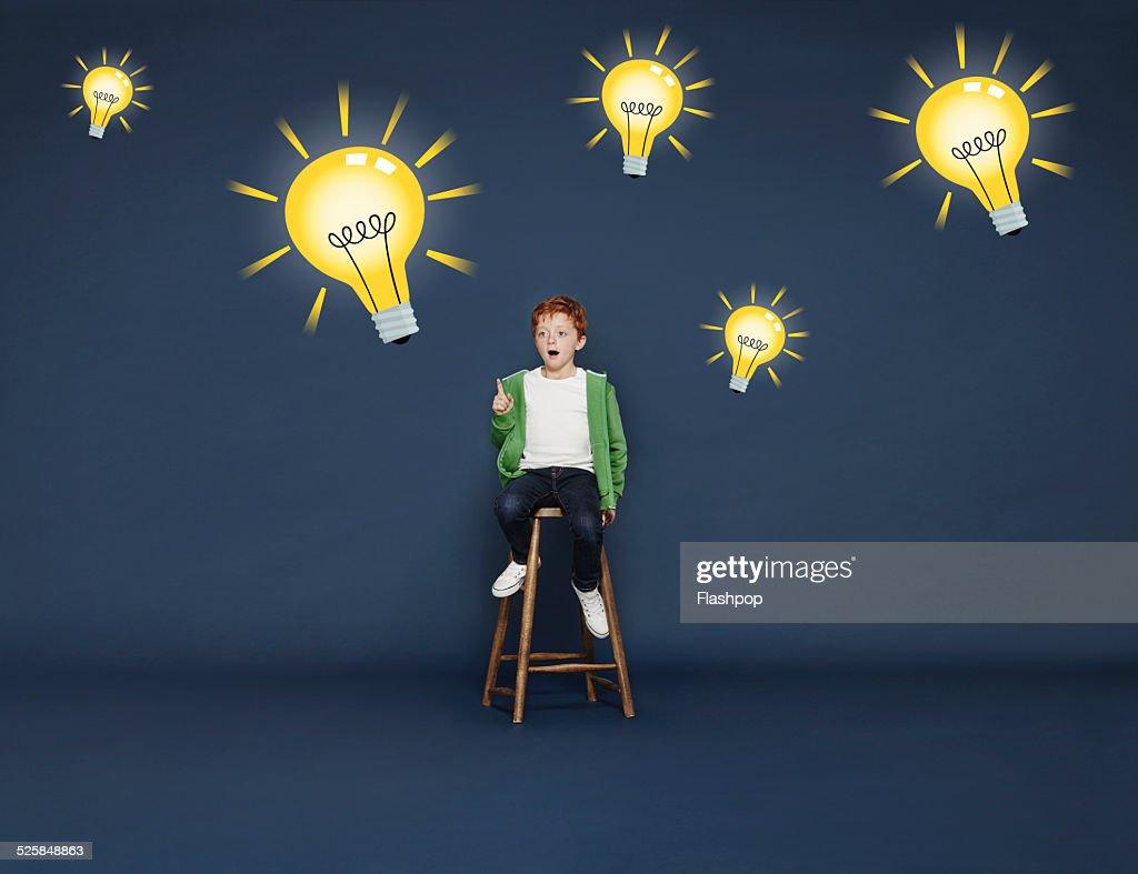 Boy with lightbulbs : Stock Photo