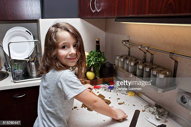 Boy with long hair making cookies