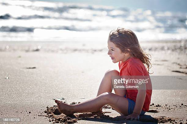 boy with long hair on the beach - israeli ethnicity stock pictures, royalty-free photos & images