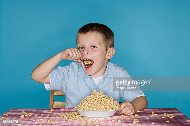 Boy with lots of breakfast cereal