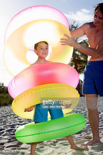 boy with lots of rubber rings