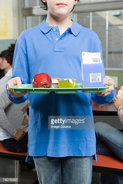 boy with lunch tray - milk carton stock photos and pictures