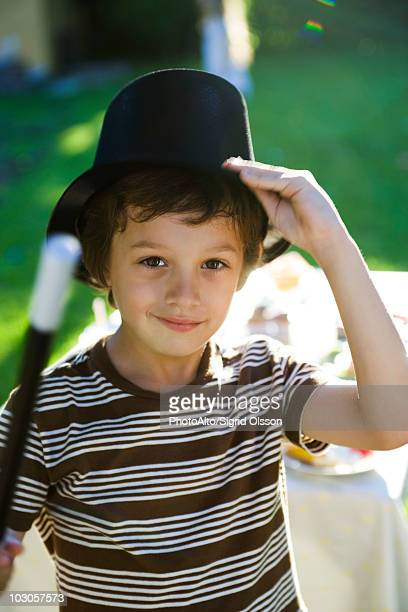 Boy with magic wand and magician's hat, portrait