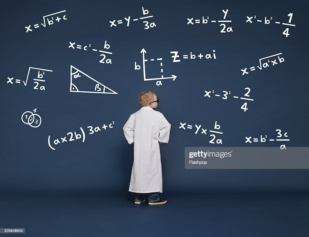 Boy with mathematical equations : Stock Photo