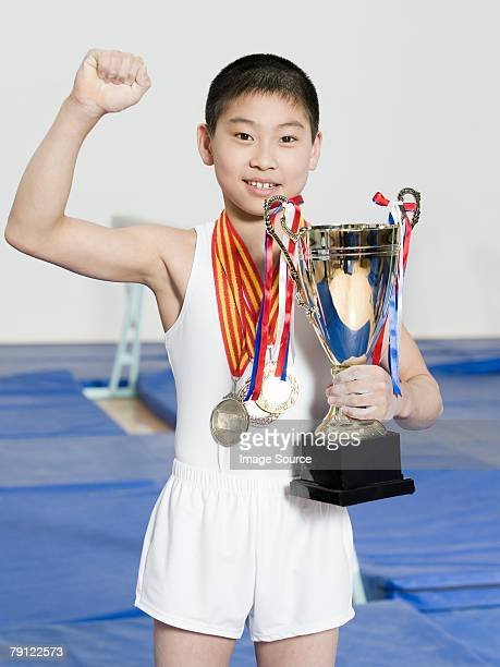 Boy with medals and trophy