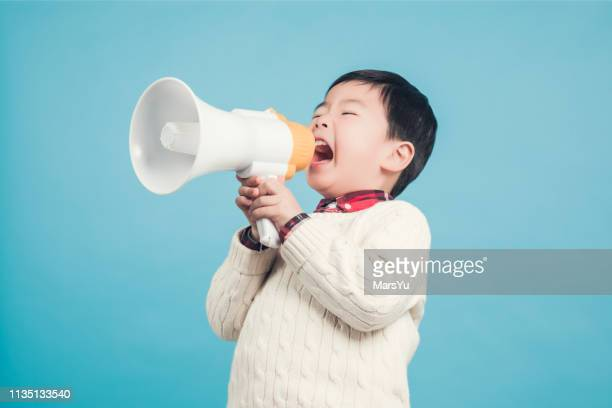 boy with megaphone making an announcement - megaphone stock pictures, royalty-free photos & images
