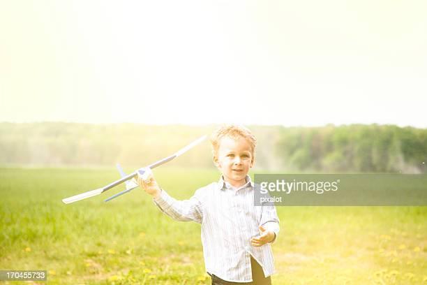 Boy with model air plane
