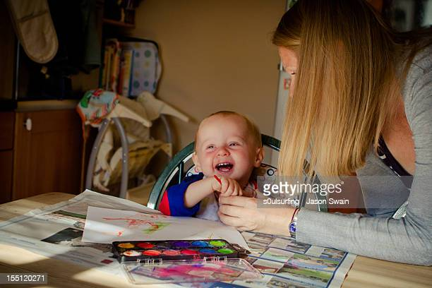 boy with mother - s0ulsurfing stock pictures, royalty-free photos & images