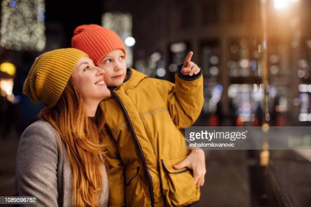 Boy with mother pointing at store window