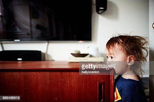 Boy With Mouth On Credenza.