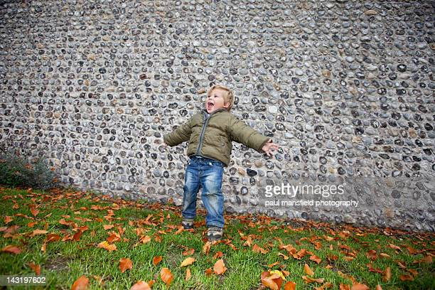 boy with outstreched arms - chert stock photos and pictures