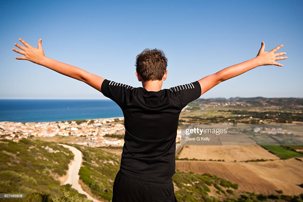 boy with outstretched arms stock photo getty images