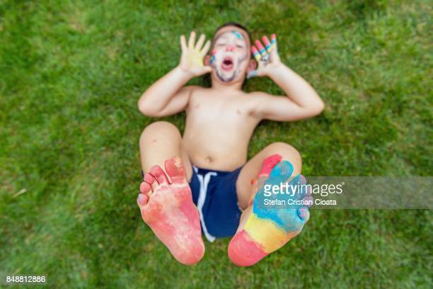 boy with painted feet sole - only boys stock photos and pictures