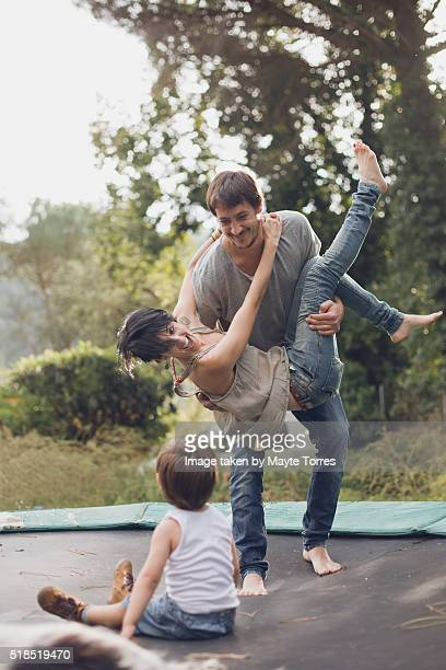 boy with parents in trampoline - crazy dad stock photos and pictures