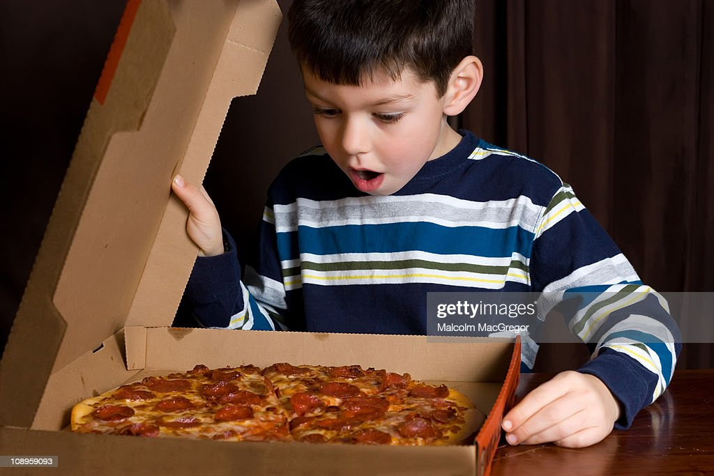 Boy with Pizza : Stock Photo