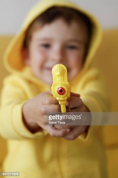 Boy with plastic gun
