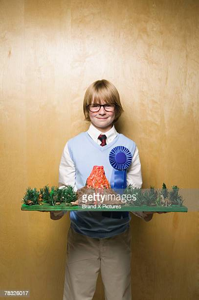 boy with prize winning model volcano - award stock pictures, royalty-free photos & images
