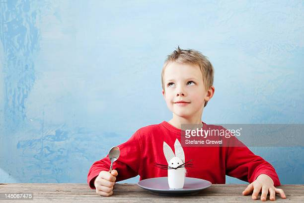 Boy with rabbit decoration on plate