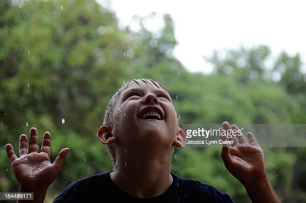 Boy with rain drops