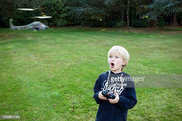 Boy with remote Helicopter