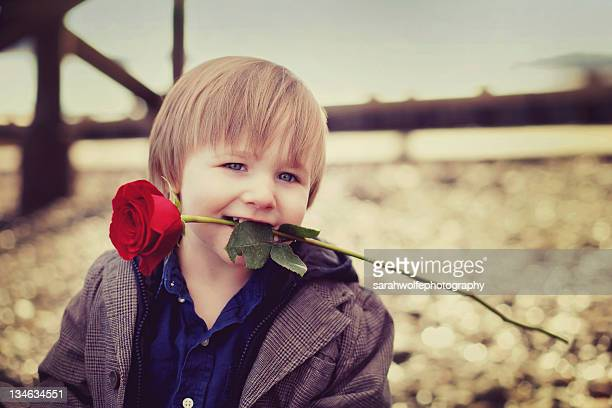 Boy with rose in his mouth