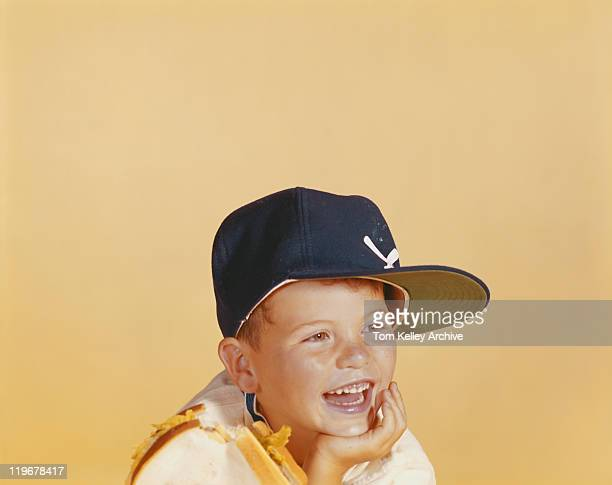 Boy with scattered food on shoulder, smiling