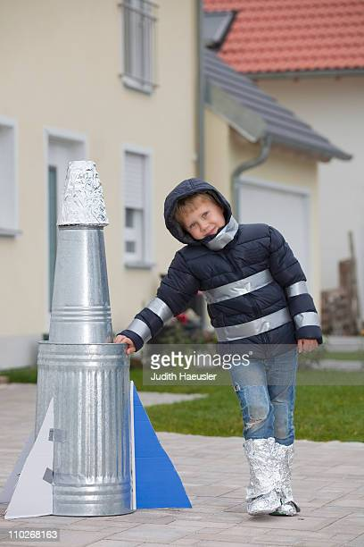 Boy with selfmade rocket, happy