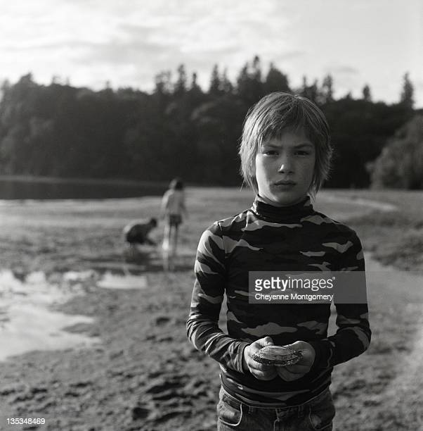 boy with shell - turtleneck stock pictures, royalty-free photos & images