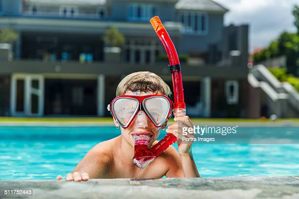 Boy with snorkel in swimming pool