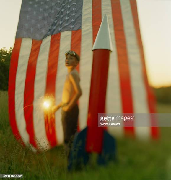 Boy with Sparkler by Flag