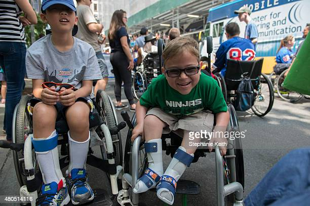 A boy with spinal bifida shares a laugh with friends during the first annual Disability Pride Parade on July 12 2015 in New York City The parade...