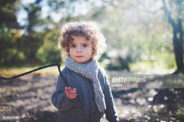 Boy with stick in hand