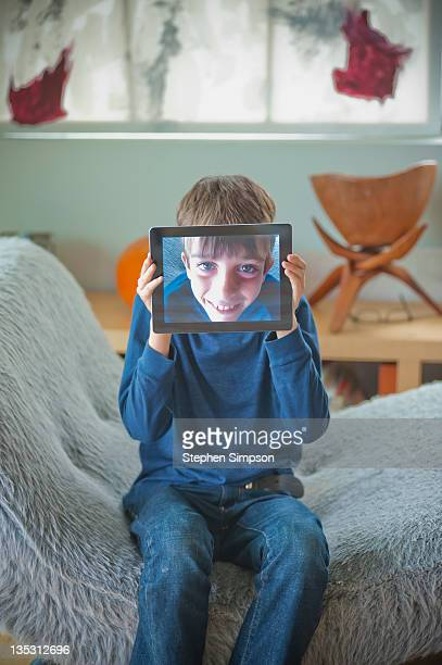 boy with tablet computer self portrait
