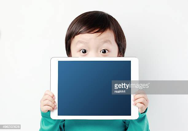 boy with tablet - digital native stock pictures, royalty-free photos & images
