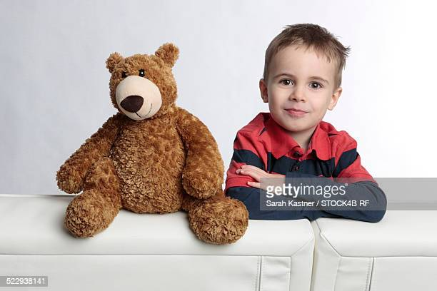 'Boy with teddy bear, portrait'