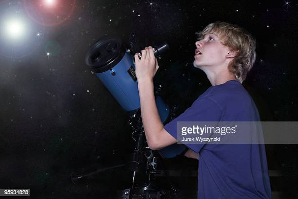 Boy with telescope looking at stars