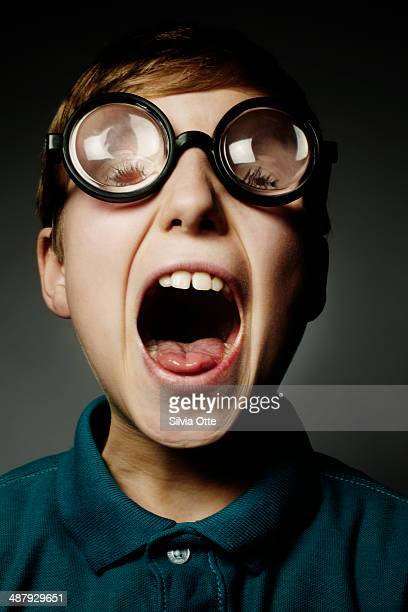 Boy with thick fun glasses screaming