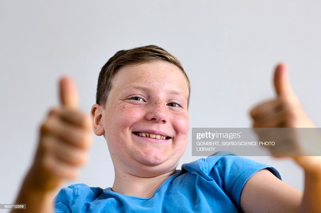Boy with thumbs up : Stock-Foto
