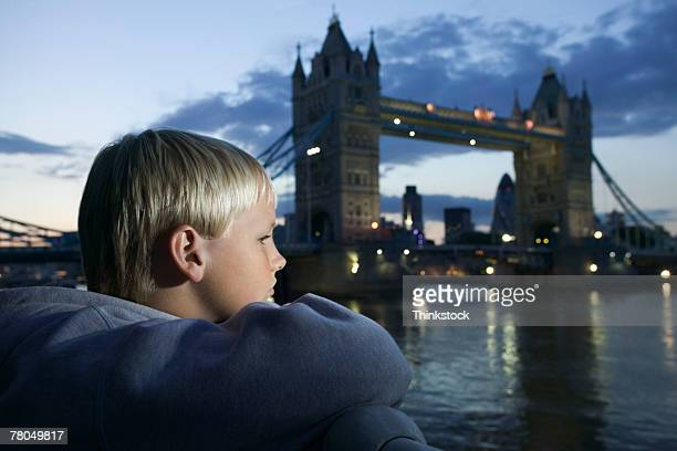 Boy with Tower Bridge background, London, England