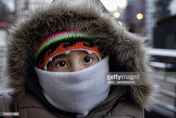 A boy with warm clothes in downtown Santiago July 21 2010 Chile faces the coldest winter of the last three years and has sustained losses that could...