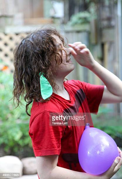 Boy with water balloon