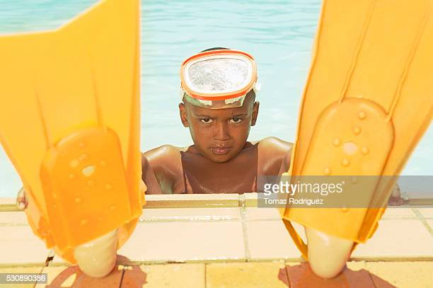 Boy with yellow flippers and swim mask