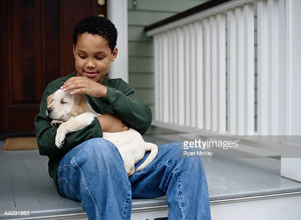Boy with Yellow Lab Puppy