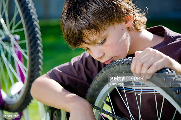 Boy Working on a Bicycle