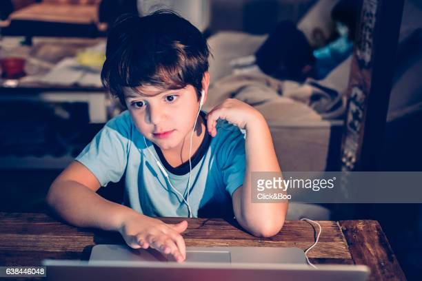 Boy working with a computer - New technologies