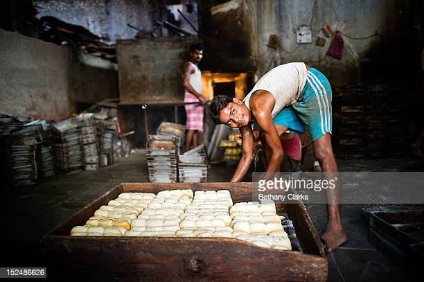 A boy works in a bakery in Dharavi November 4 2011 in Mumbai India Dharavi Asia's largest slum situated in the centre of Mumbai One million people...