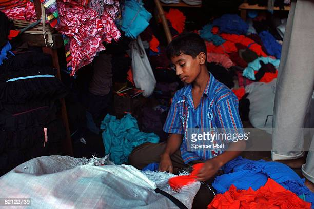 A boy works in his father's textile shop July 30 2008 in Dhaka Bangladesh Although child labor is illegal in Bangladesh an estimated 49 million...