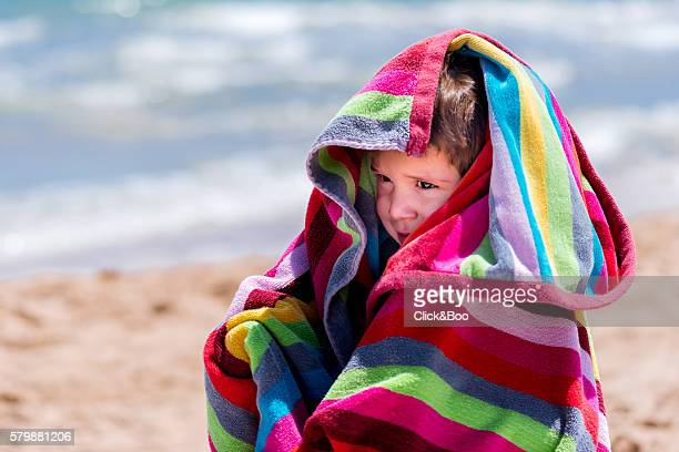 Boy wrapped in a towel